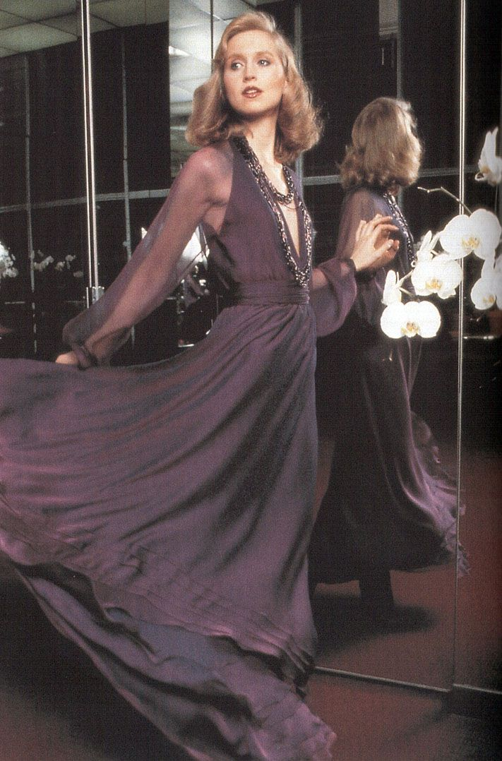 Chris Royer in a dress by Halston