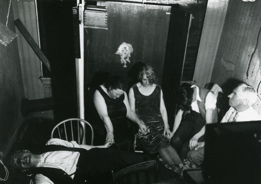 "A well-known medium, Mina ""Margery"" Crandon conducting a séance"